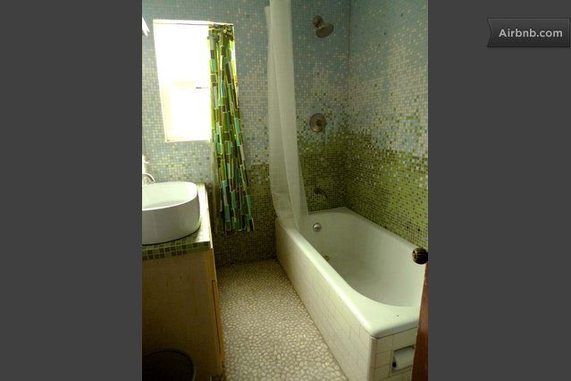 I like it a lot. The different value of the green mosaic make the wall looks pretty and more nature.