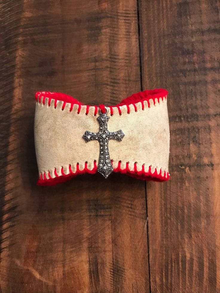 A personal favorite from my Etsy shop https://www.etsy.com/listing/587930967/baseball-bracelet-cuff-with-a-cross