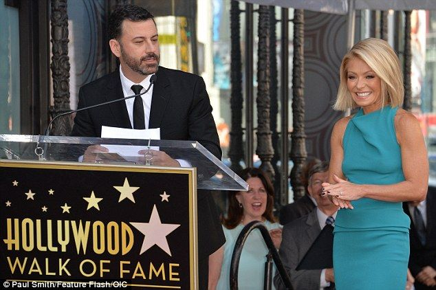 ♥♥♥Kelly Ripa♥♥♥ Saying a few words: Jimmy delivered a speech at the podium, as Kelly stood beside him and ...
