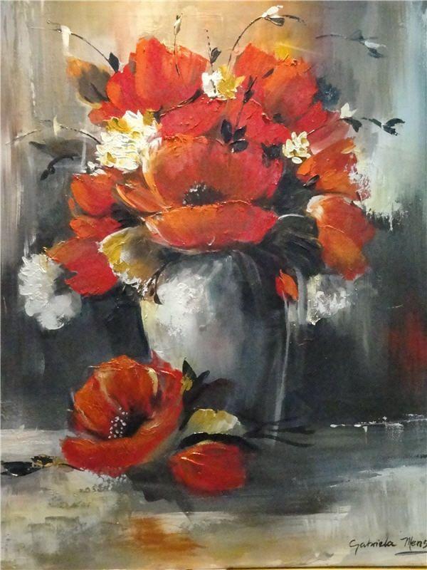 Jarrón con flores rojas