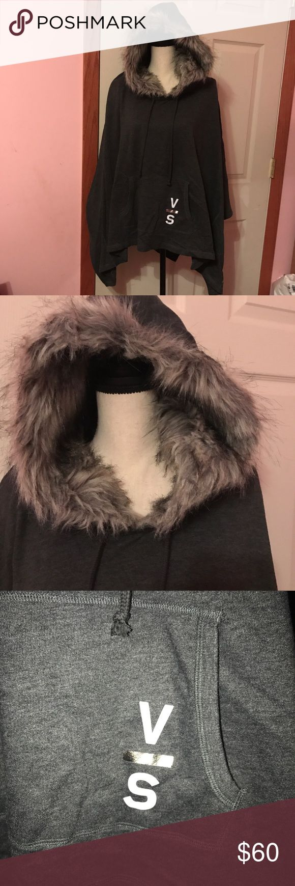 Nwt Victoria's Secret poncho with fur hood Size XS/S but can also fit M/L. Dark grey. Faux fur lined hood. Victoria's Secret Jackets & Coats Capes