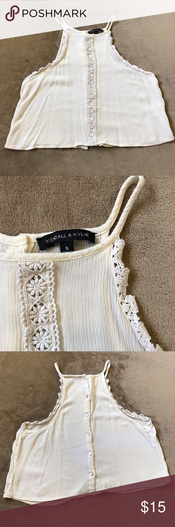 Kendall & Kylie Crop Top Cream colored flare crop top with button up back and lace trim detailing. Size small. 100% rayon. Excellent condition reposh no stains or signs of wear. I just have quite a few similar shirts and I'm trying to downsize Kendall & Kylie Tops Crop Tops