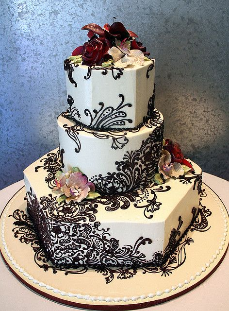 Henna Wedding Cake - Indian henna design for a couple that has the bride from India. All edible buttercream decoration. Gumpaste flowers.