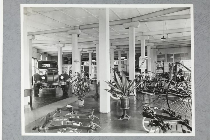 One of four black and white photographs attached to an album page. The page is one of 28 that previously made up a photograph album containing black & white photographs of the International Harvester Company's state branch offices and showrooms throughout Australia. Part of a large collection of glass plate and film negatives, transparencies, photo albums, product catalogues, videos, motion ...
