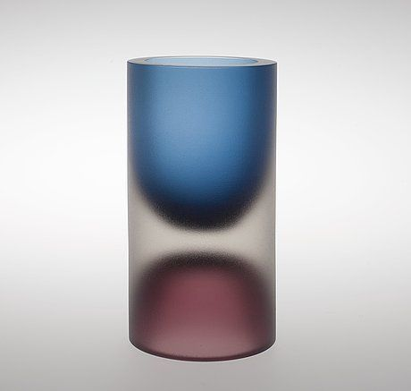 TAPIO WIRKKALA, A VASE, 3584, 3894 Signed Tapio Wirkkala, Iittala 3894 Signed Tapio Wirkkala, Iittala 3894. In a half-mold shaped crystal, colour cased, polished and etched. Height 20,5 cm.
