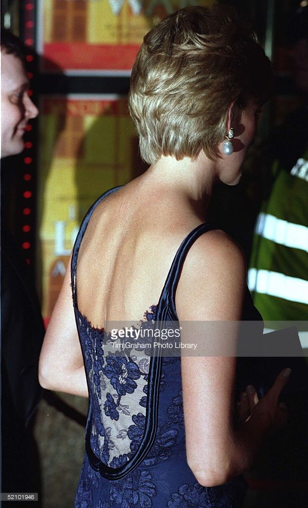 Diana, Princess Of Wales, Attending The Premiere Of The Film 'in Love And War' At The Empire In Leicester Square In Aid Of The British Red Cross Anti-personnel Mines Campaign. The Princess Is Wearing A Tight-fitting Blue Lace Dress Designed By Catherine Walker.