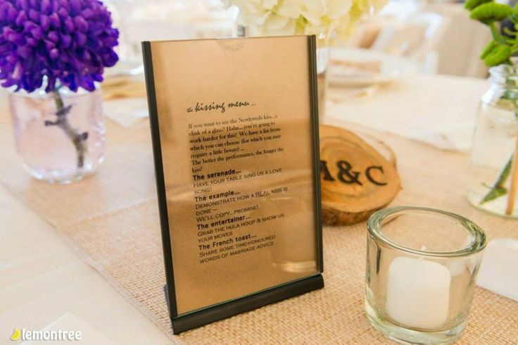 A unique kissing menu for the serenade for this rustic wedding.
