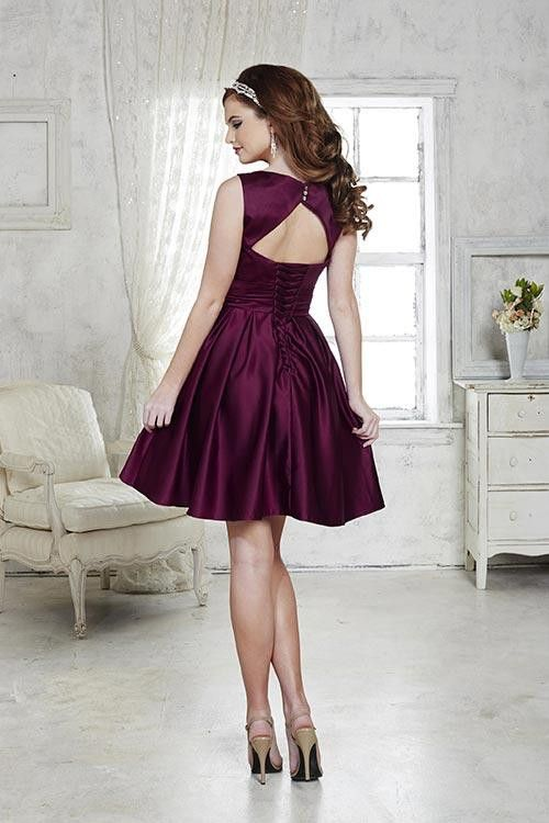 Short satin dress with pleated skirt, bateau neckline, and keyhole open back…