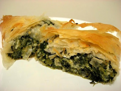 Spanikopita....spinache, onion, feta with lemon juice olive oil and salt in many layers of buttery paper thin phillo dough crust.....so-o-o good  this isn't rocket science...I've been cooking w phillo dough since I was 18