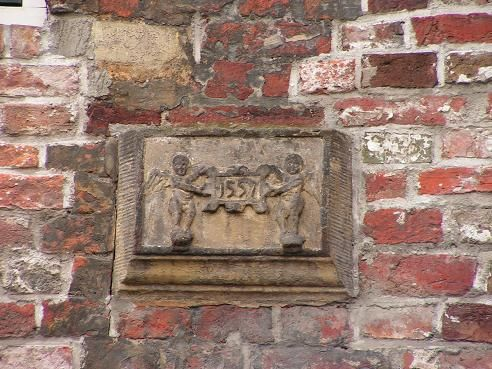 The oldest stone tablet (1557) to see in the Sieboldsgang out of  the Gelkingestraat in the city of Groningen, The Netherlands