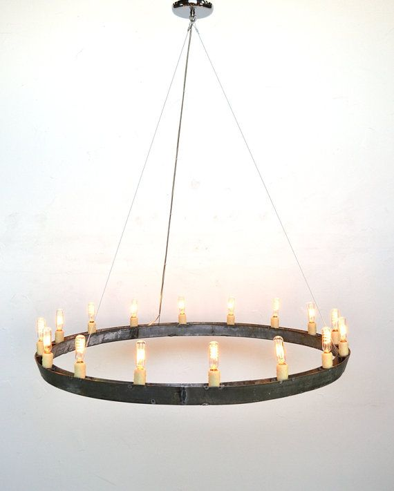 wine barrel lighting. repurposed barrel rings use tea lights and black chain instead or barbed wine lighting t