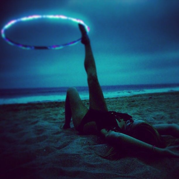 Led foot hooping on the beach. such a pretty picture!