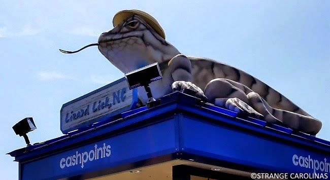 There is a giant lizard on top of an (the?) ATM in Lizard Lick, NC. The Lizard Lick ATM Lizard is right across the street from Lizard Lick Towing, which was featured on the aptly-named truTV series Lizard Lick Towing. The Lizard Lick ATM Lizard wears a hat. I do not know why.  Side note: if you ever want to get lots of dirty looks, take photos of an ATM. People love it!