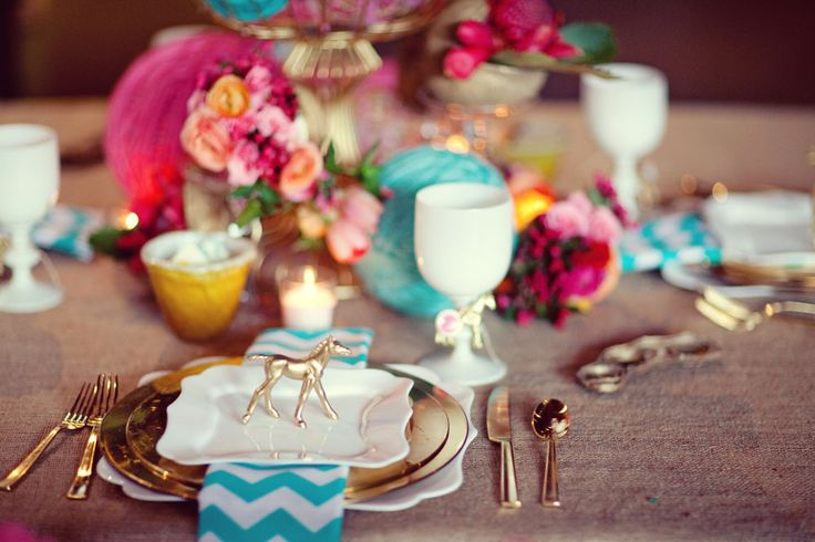 Color palette: white, gold, turquoise and shades of pink.
