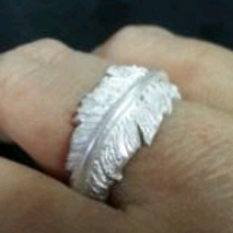 Lucita Rembeth delicate feather ring. The thin rolled line sit atop the feather add contrast of the ring