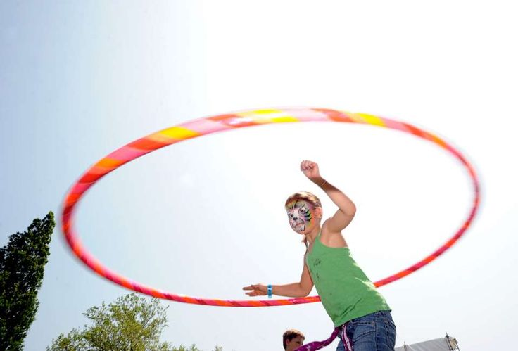 Elena Higgins, 6, of Greenwich, displays her hoop skills during the Greenwich Town Party at Roger Sherman Baldwin Park, Saturday, May 26, 2012.