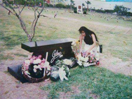 Interesting pic seems as if she was putting flowers on her own grave.