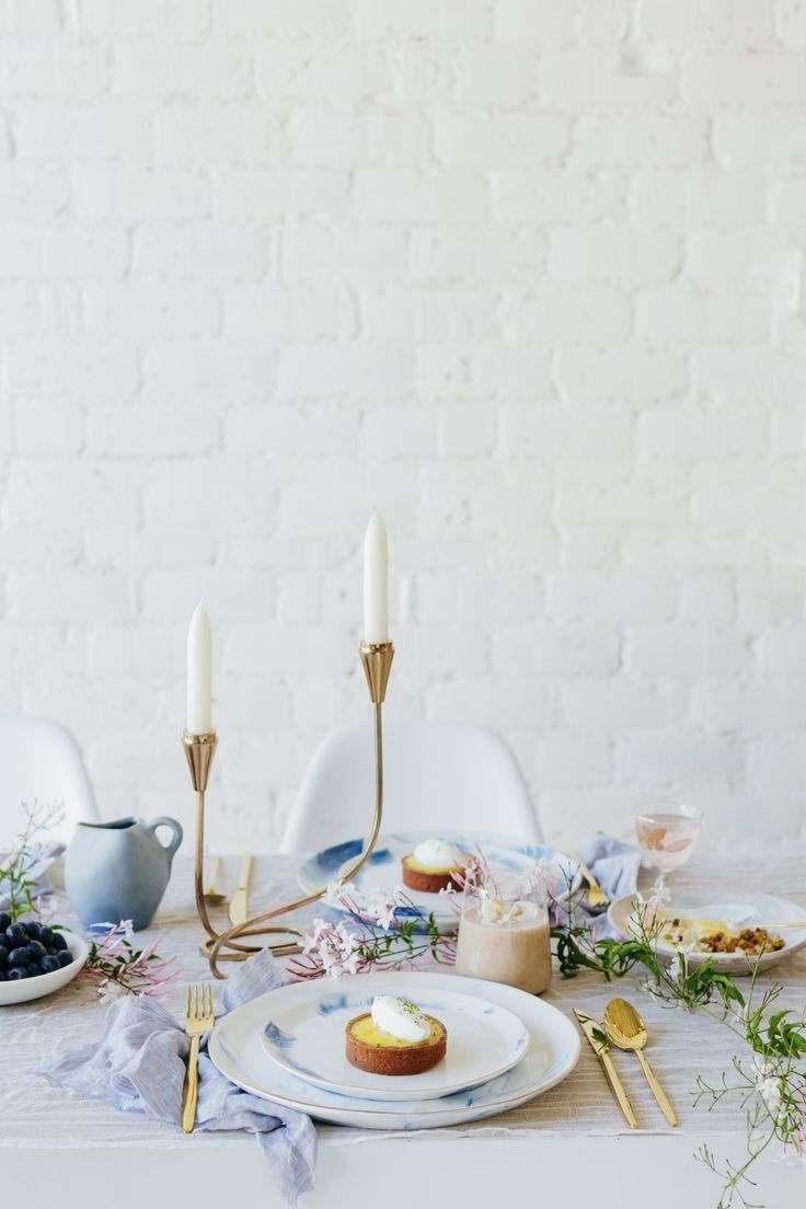 Shop Strata Side Plate, Strata Dinner Plate, Doma Flatware, Color-Drop Stemless Wine Glass, Cursive Candlestick and more