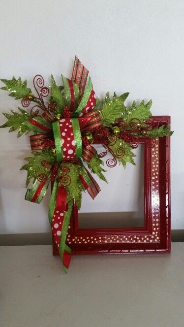 Alternative Christmas wreath made from a repurposed picture frame.: