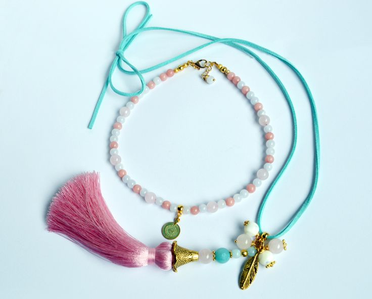 'PinkTreasure' Unique Breaded Necklace 'PinkTreasure' Made out of Jadeite (6 mm), Rose quartz (8-10 mm) and Amazonite (10 mm) beads and metal inserts, tassel Length: 54 cm Necklace come in original 'Buddha Touch' box