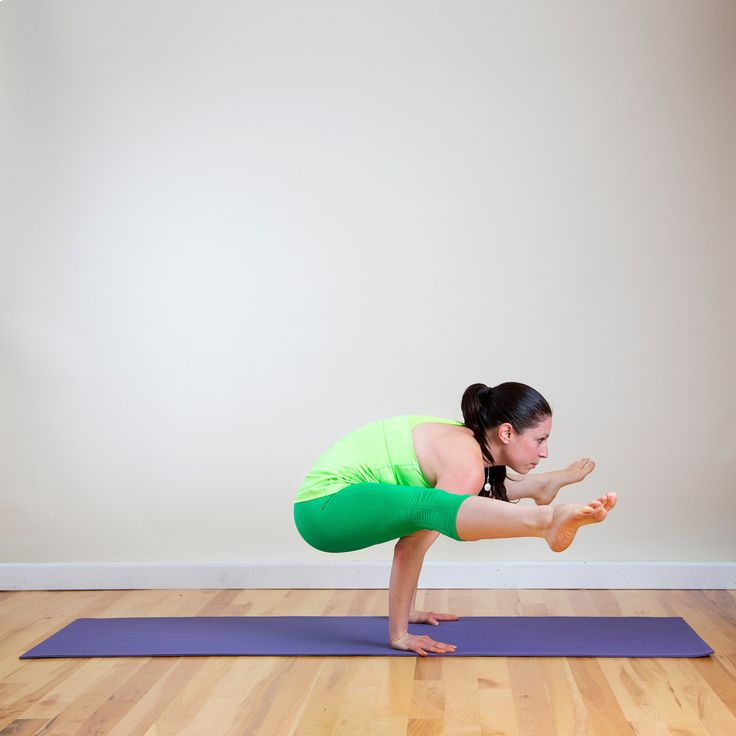 This arm-balancing pose will tone your arms and increase flexibility in your hamstrings.  Begin in Downward Facing Dog. Jump your feet up, so they land behind your hands.  Bring your hands back through your legs, and press your palms into your calves, trying to crawl deeper through your legs. Once your arms and shoulders are as far back behind your thighs as you can get them, plant your palms firmly behind your feet, cupping your heels with your thumb and index finger. Bend your knees, and…