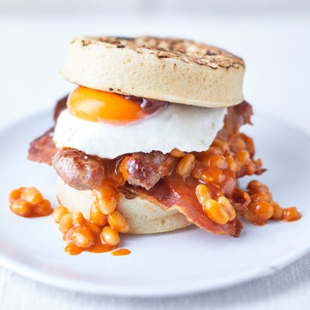A real brunch extravagance, this Full English crumpet sandwich has everything you want from a breakfast, including sausages, bacon, fried egg and baked beans