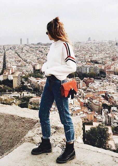White oversized sweater Jeans Dr martens Orange shoulder bag