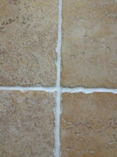 Green Spring Cleaning Recipe for the Grout :)  7 cups water, 1/2 cup baking soda, 1/3 cup lemon juice and 1/4 cup vinegar - throw in a spray bottle and spray your floor, let it sit for a minute or two... then scrub :)