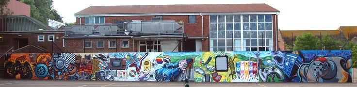 Graffiti workshop with a group of kids atThe Woodrfoffr School. Tennis court wall with a technology theme