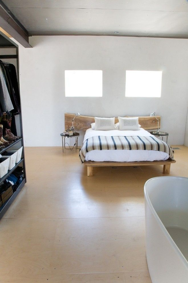 scandinavian style bedroom idea with wood bed plus log cut headboard light beige floors black walk in closet storage system and white bathtub of Feel Your Ultimate Sleeping with These Tens of Cozy & Simple Wood Bed Design