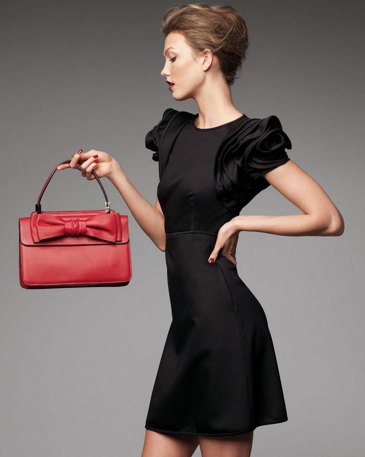 Karlie Kloss in Valentino cocktail dress & bow bag