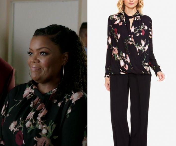 """1x06 by Kirsty0 Comments Dina Rose (Yvette Nicole Brown) wears this long sleeved black floral rpinted tie neck cut out blouse in this episode of The Mayor, """"Will You Accept This Rose?"""". It is the Vince Camuto Windswept Bouquet Printed Wrap Top. Buy it HERE for .99."""