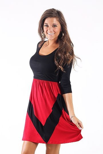 """Aim For It Dress, Black/Red $38.00 We couldn't pick a better game day dress for a nice fall Saturday football game! Show your team spirit and have a look you can wear again and again!   Fits true to size. Miranda is wearing a small.   From shoulder to hem:  Small- 34.5""""  Medium- 35""""  Large- 35.5"""""""