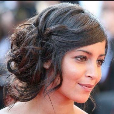 Leila Bekhti, en version belle des champs avec un chignon romantique, lors du 62ème Festival de Cannes, en mai 2009.
