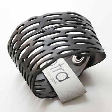 300 Km Bracelet by OTRA Design. Made from recycled bicycle tires.