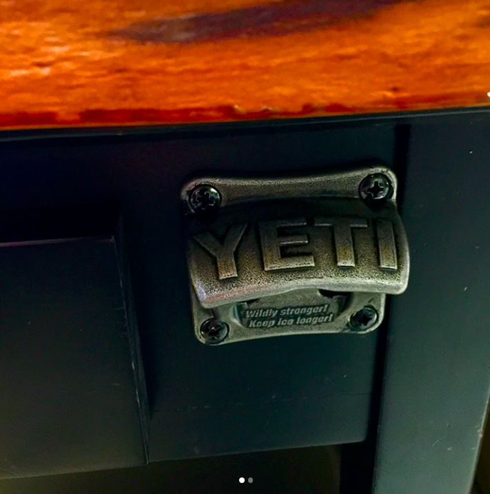YETI bottle opener attached to my fly tying desk.