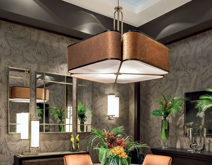 "The sheer, sumptuous finishings of cotton and velvet fabrics of ""Quadrifoglio"" lighting collection play with the subtle four-leaf clover design and the satin finishings of the lampshade, to create an ambient of sophisticated, upscale class. The light filtered through the different structured fabrics of the lampshade becomes more intense and alluring – the perfect setting …"