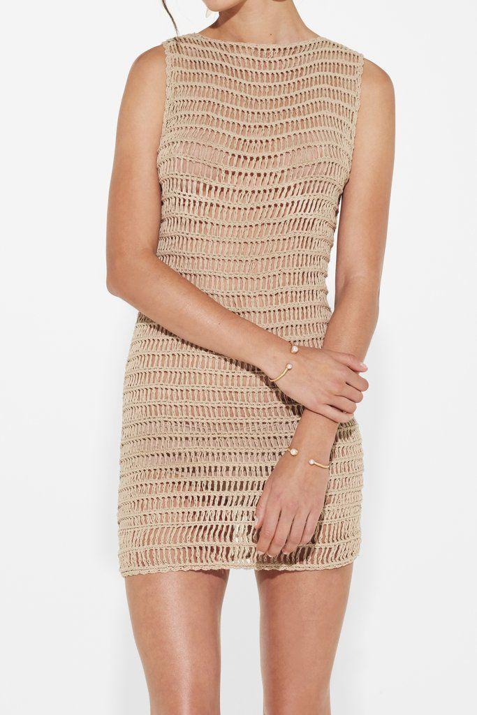 fef6e7ca7931 Crochet mini tank dress with a boat neck line. 100% Cotton crochet. Model  wears size 1.