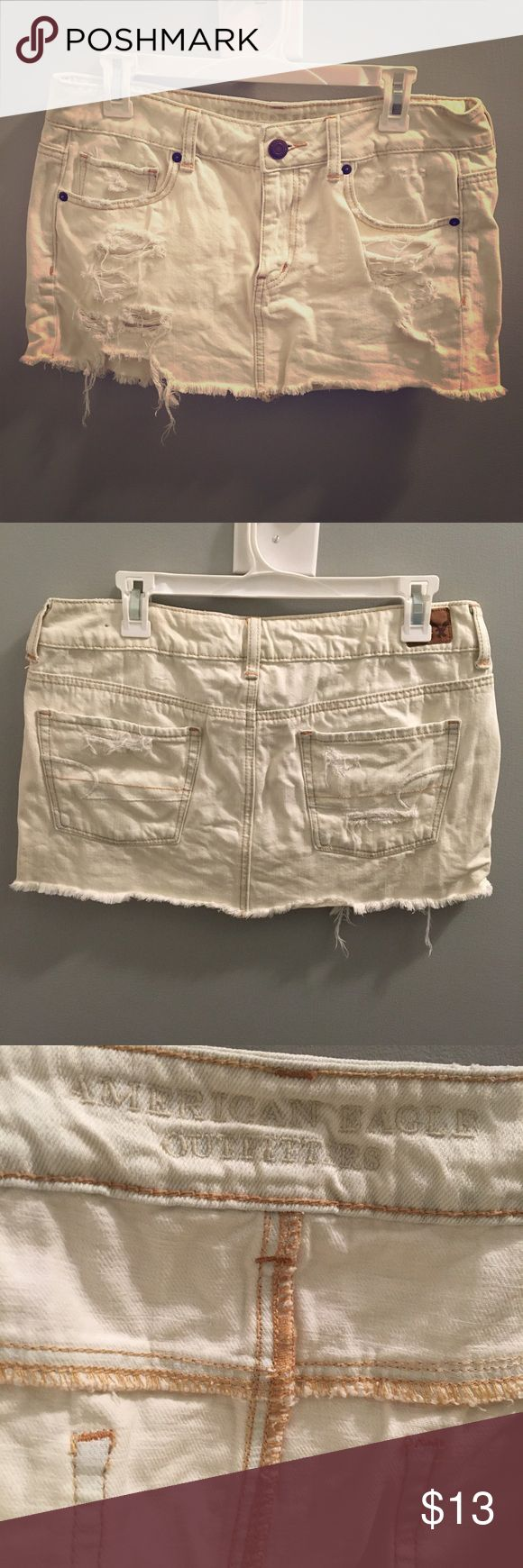 Distressed Denim American Eagle Mini Skirt Off white denim mini skirt with factory distressing! Super cute rips and holes! Adorable summer staple! A must have in any girl's closet!:) American Eagle Outfitters Skirts Mini