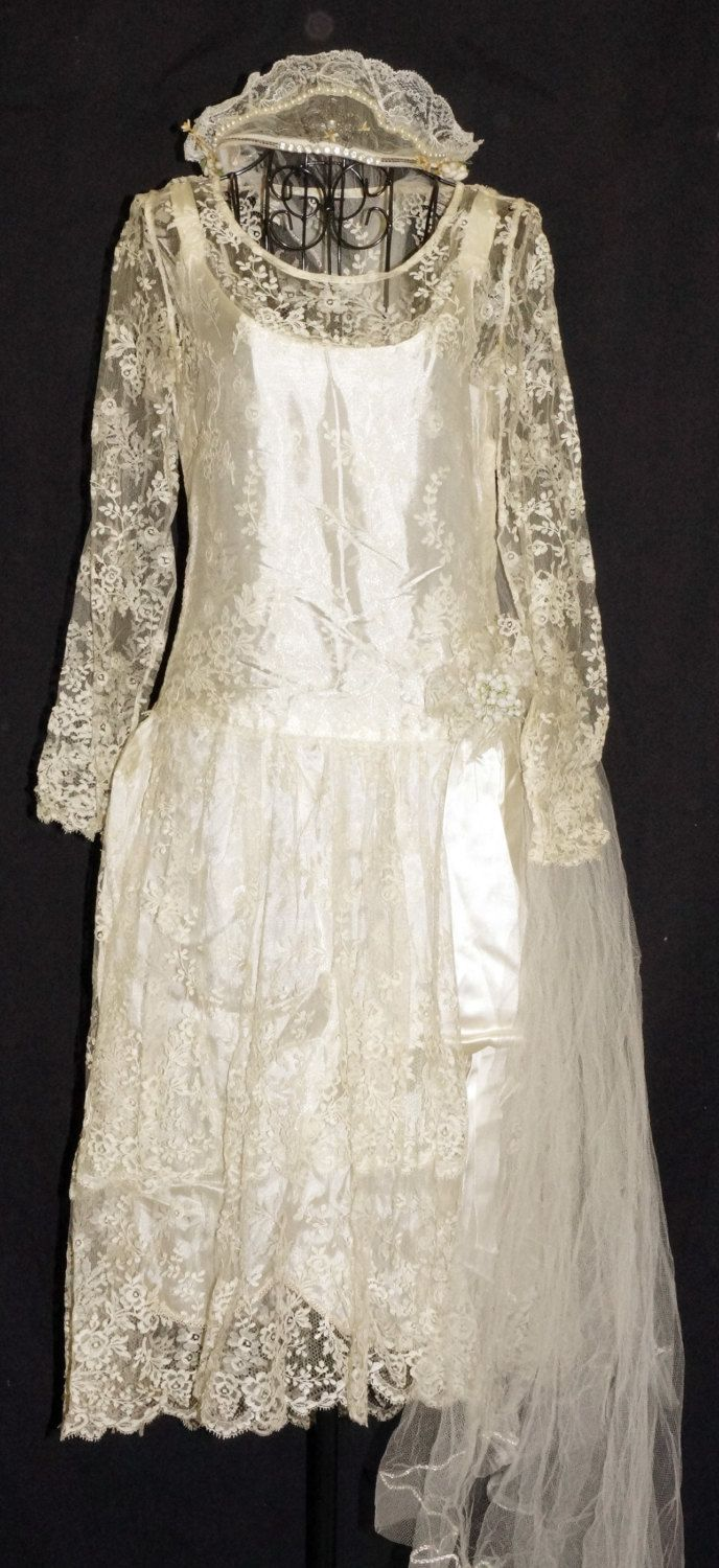 COUPON CODES DO NOT APPLY TO THIS ITEM Womens ivory silk lace wedding dress with veil. This dress is fragile and has some slight issues that need attention by a dress restoration specialist or other sewing professional. Overall condition is good, needs cleaning. I would recommend this dress be used for display or media use rather than an actual wedding due to its fragile condition unless you plan on doing nothing but walking down the aisle and then changing into other attire post wedding. It…