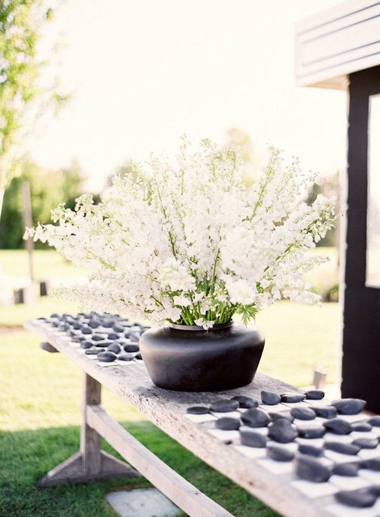Natural stones make a great alternative to the traditional guest book. Have your guests to sign them then permanently display them in your home or garden after the wedding. Love this idea!!