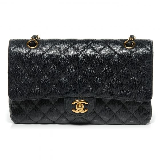 This is an authentic CHANEL Caviar Quilted Medium Double Flap Bag in Black.   This stunning shoulder bag is crafted of Chanel signature caviar leather with a diamond quilting.