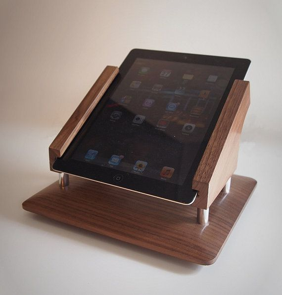 iPad stand for square payment system, (or whatever you want it for.) Vertical orientation, and has a swiveling base (lazy Susan type) w magnetic detens that hold the stand in facing customer and/or facing cashier .turn bolt holds iPad securely made of wood, and aluminum satin finish (same finish as back of iPad )        Dimensions (WxHxD) 10 x 6.5 x 8.5  Requires 13.5 diameter circle of clear counter space to rotate freely