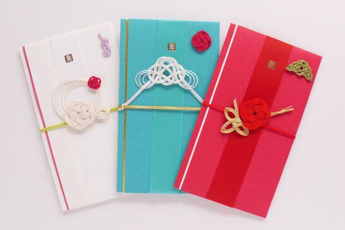 「金封(ご祝儀袋)/結婚祝・スタイリッシュ」 左から、ハナグルマ・フジ・ショウチクバイ。パッと目を引く色彩、お洒落で斬新なデザインが印象的! 人と差をつけられるスタイリッシュで可愛いお祝儀袋が揃っています。