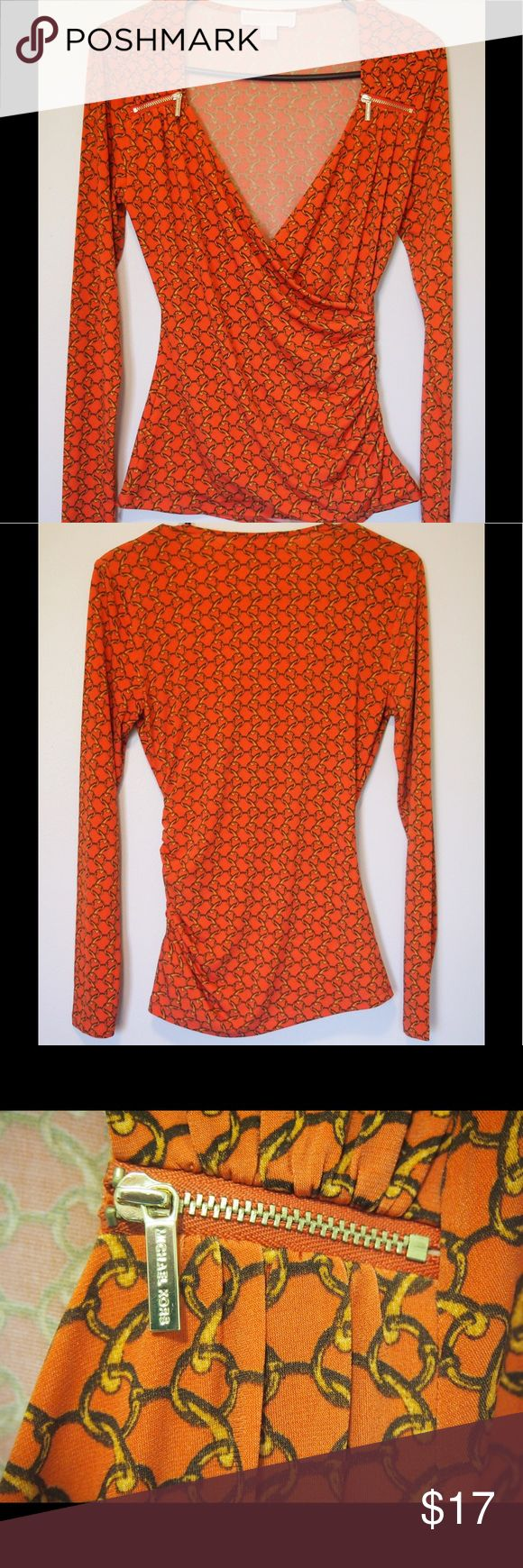 Michael Michael Kors Orange Woman's Top Size XS This is a Michael Michael Kors Orange Women's top size XS. The top is 95% polyester and 5% Spandex. The top has no flaws nor defects. In perfect condition. Any questions please do not be shy and ask before purchasing. Thanks MICHAEL Michael Kors Tops Blouses