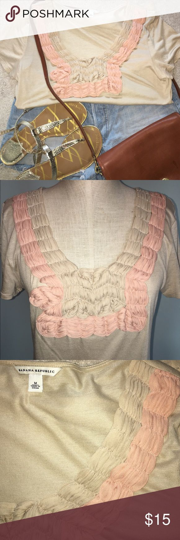 Banana Republic tan t-shirt with pink design Banana Republic t-shirt with gorgeous tan & pink decor on front. Love this shirt, but it's just sitting in my closet. Super cute for the spring/summer. Size M Banana Republic Tops Tees - Short Sleeve