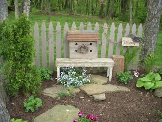 wooden bench with large birdhouse primitive area in the garden Snippets from the Onion Patch