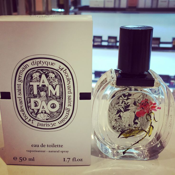 Diptyque's Eau de Toilette spray was painted with a curved stem of red rose.