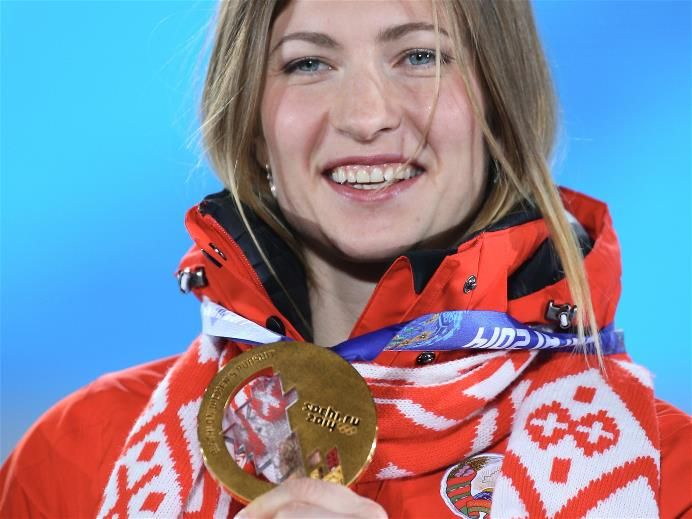 DAY 5:  Gold medalist Darya Domracheva of Belarus celebrates during the medal ceremony for the Biathlon Women's 10km Pursuit