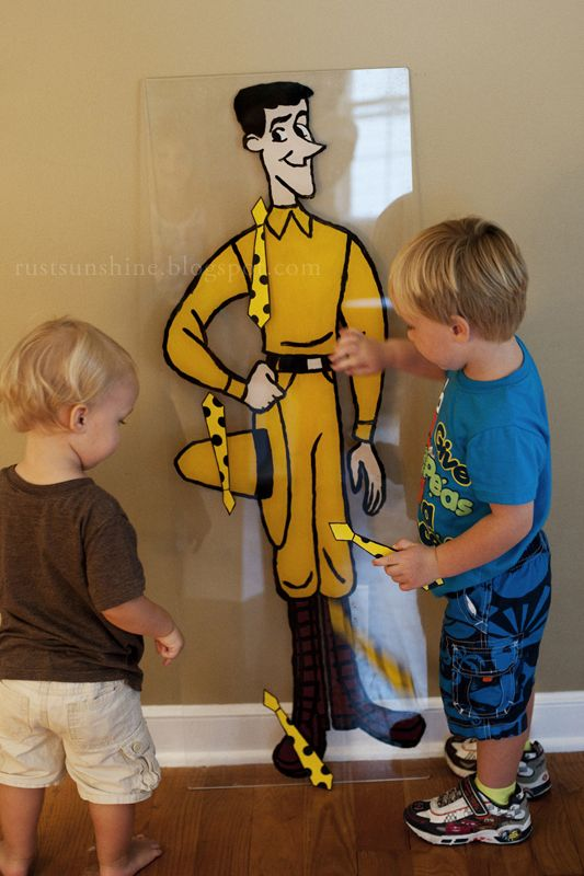 Pin the Tie on The Man in the Yellow Hat - party game idea for a Curious George Birthday Party